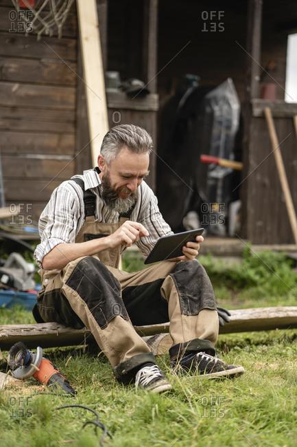 Carpenter using digital tablet during break