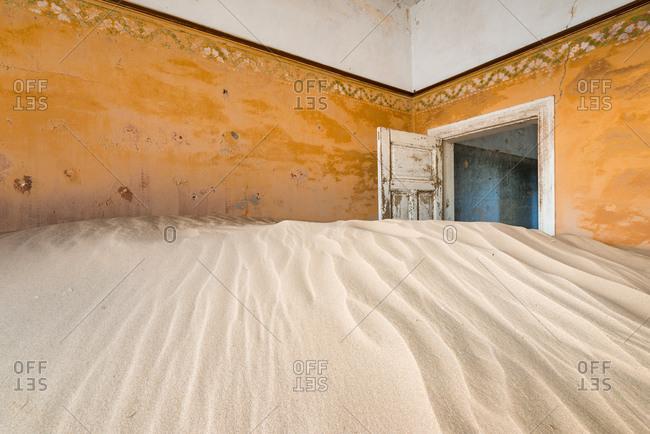 The abandoned diamond mining ghost town of Kolmanskop in the Namib Desert
