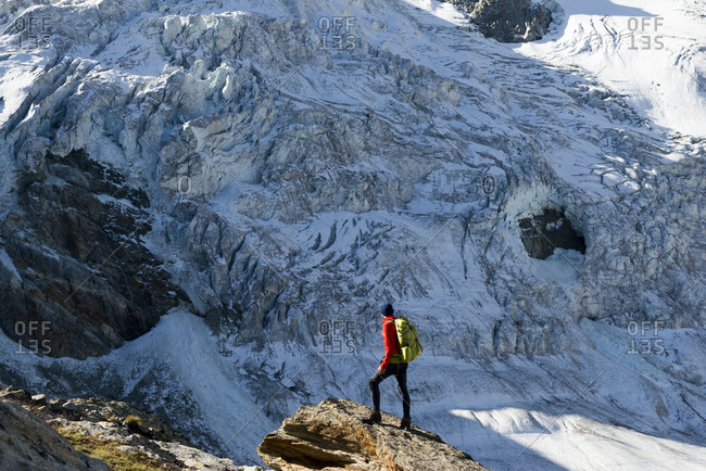 The Moiry glacier with the serac strewn icefall at the foot of Grand Cornier and Pointes de Mourti trekking the classic Walkers Haute Route from Chamonix to Zermatt in the Swiss Alps