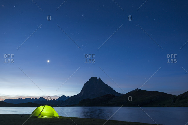 Camped beside Lac Gentau with views of Pic du Midi d'Ossau on the GR10 trekking route in the French Pyrenees