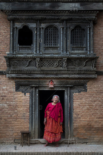 Traditional decorative Newari hand carved wood windows and architecture on a temple in an historical little village