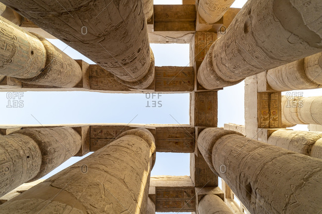 Pillars decorated with Hieroglyphics in the Great Hypostyle Hall at Karnak Temple