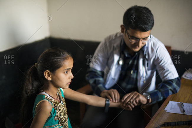 Young girl being examined by male doctor at a hospital in Nepal