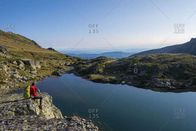 Taking a break from hiking and looking out over Maliovitsa lakes in the Rila mountains