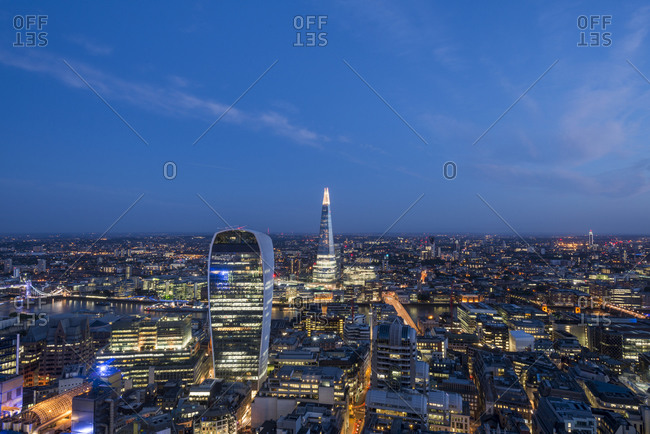 London, Greater London, United Kingdom - July 21, 2015: Night time view of The Walkie Talkie (20 Fenchurch Street) and The Shard in London taken from the top of Tower 42 in the city