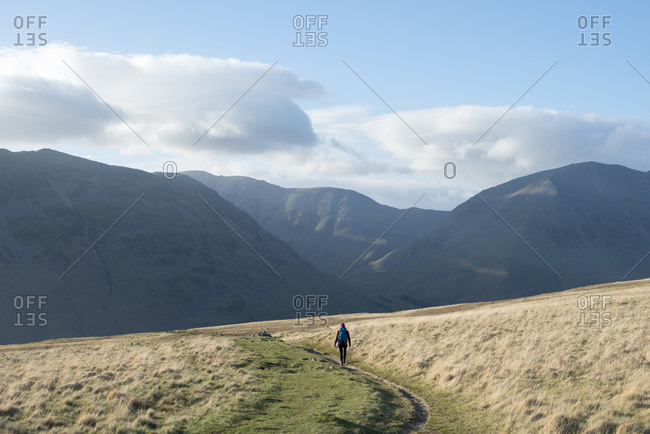 Trekking in the English Lake District in Wast Water with views of Kirk Fell and Great Gable in the distance