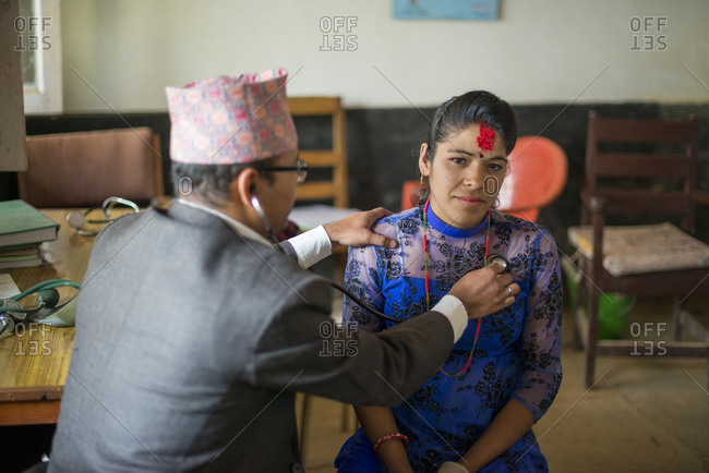 A woman has her heartbeat checked by a doctor in a hospital in Nepal