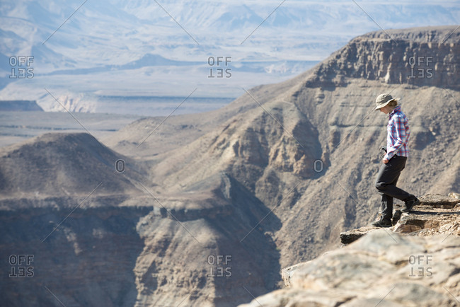 A woman hikes down into the Fish River Canyon in Namibia