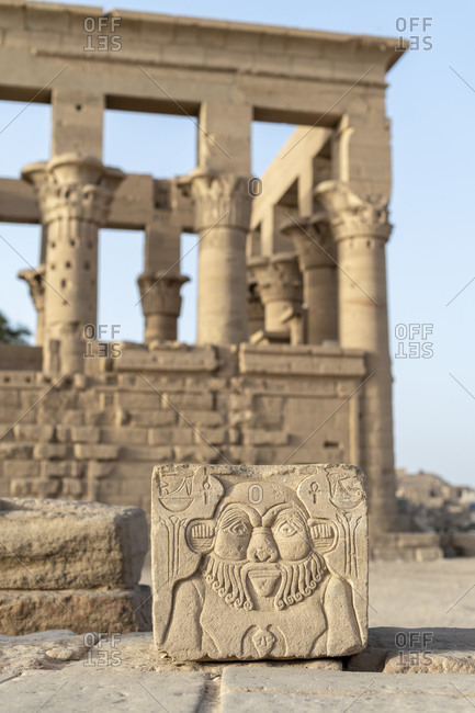 Ornately carved face in stone beside the temple of Isis on Philae Island