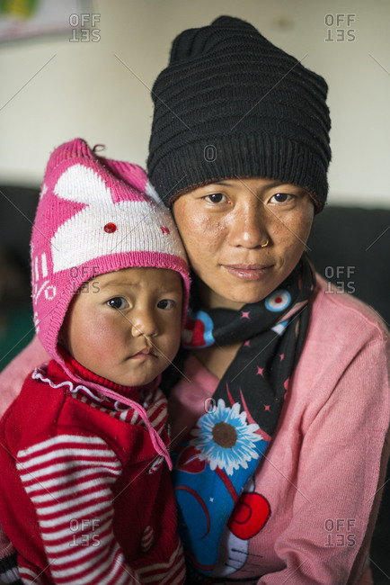 Diktel Hospital, Nepal - December 9, 2015: A mother holds her baby girl in a small rural hospital in Nepal, Khotang District