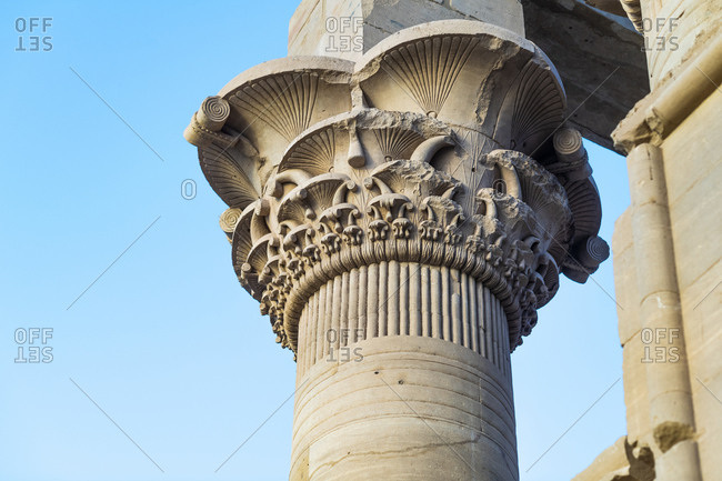 Ornately carved detail in the stone at the top of the columns of the temple of Isis on Philae Island