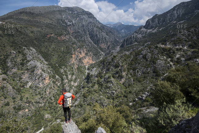 A man hiking in the Taygetos mountains on the Mani peninsula in the Peloponnese in Greece