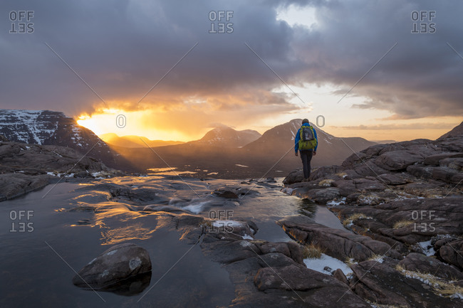 Hiking in the Scottish Highlands in Torridon along The Cape Wrath Trail near Loch Coire Mhic Fhearchair