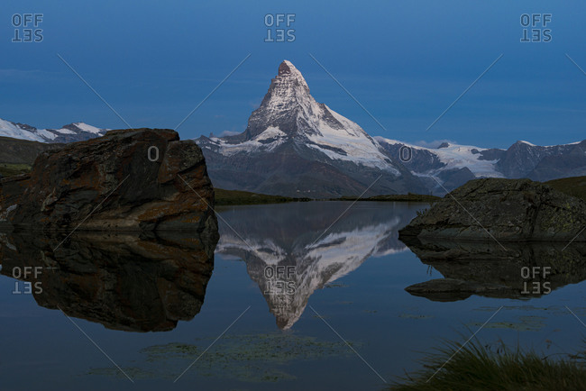 The Matterhorn reflected in Stellisee lake in the Swiss Alps
