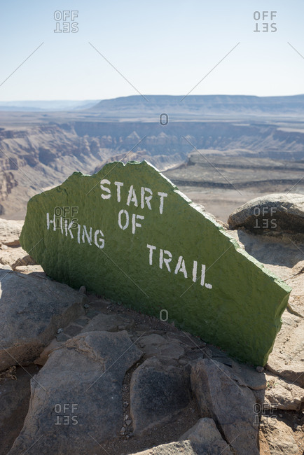 A stone sign marks the beginning of the hiking trail into the Fish River Canyon in Namibia