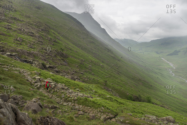 Trekking along Mickeldon Valley in Great Langdale towards Bowfell in the Lake District in the UK