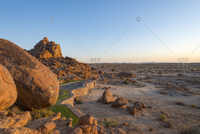 A swimming pool among boulders at Canyon Lodge near the Fish River Canyon in the desert in Namibia