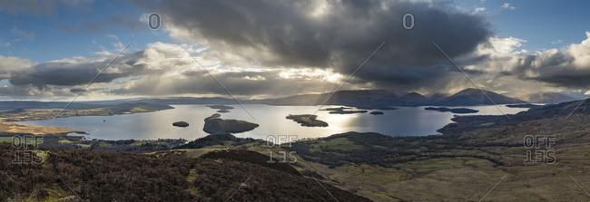 Hiking down from the top of Conic Hill towards Loch Lomond along The West Highland Way