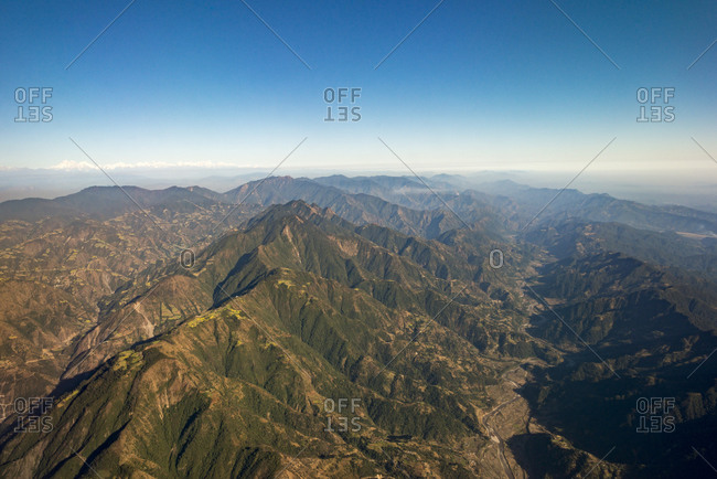 Flying over Nepal with views across the Himalayas shortly before landing at Kathmandu