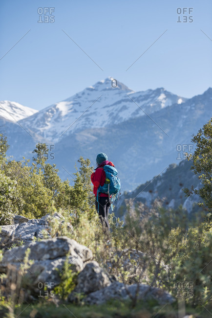 A woman trekking in the Taygetos mountains on the Mani peninsula in the Peloponnese in Greece