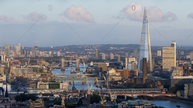 London, United Kingdom - August 26, 2015: A view of London and the Thames river from the top of Centre Point tower. The Shard, Tate Modern and Tower Bridge are visible.