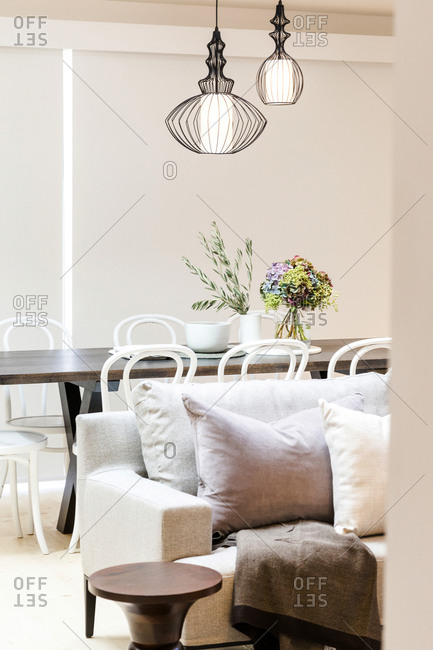 Dining room with large rustic table under black wire light fixture