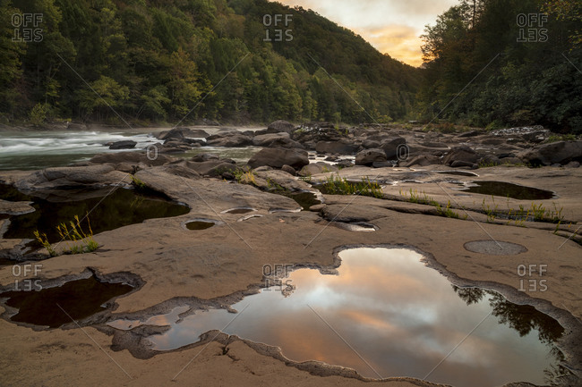 Sunrise over rocky riverbank at Gauley River National Recreation Area, Fayetteville, West Virginia