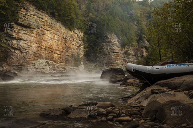 Boats on the foggy shore at Gauley River National Recreation Area, Fayetteville, West Virginia