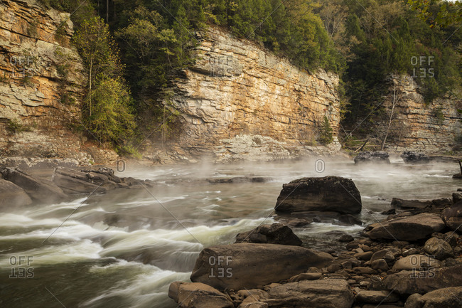 Misty waters by rocky hillside at the Gauley River National Recreation Area, Fayetteville, West Virginia