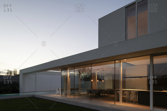 November 12, 2020: Exterior of a modern residential home with a long infinity swimming pool