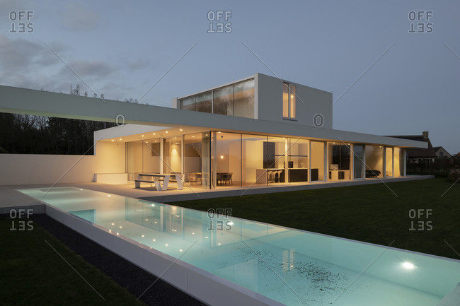 November 12, 2020: View of a contemporary residential home with infinity swimming pool at sundown
