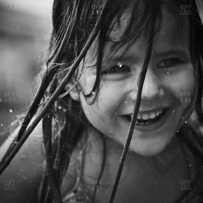 Girl playing with water on a hot summer day