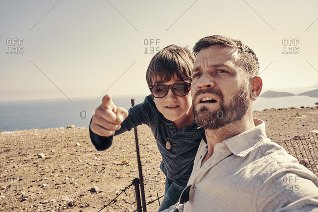 Father and son on a road trip in a dry area