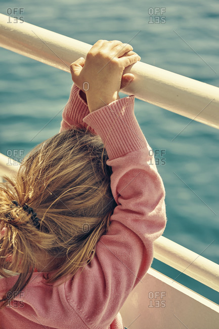 Small girl staring at the sea from a boat