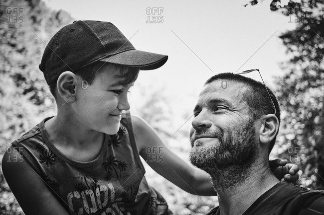 Father and son sharing a bonding moment in black and white
