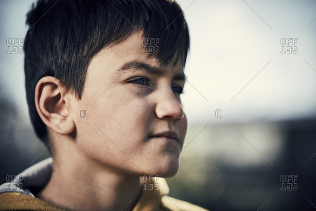 Face of a young boy looking away