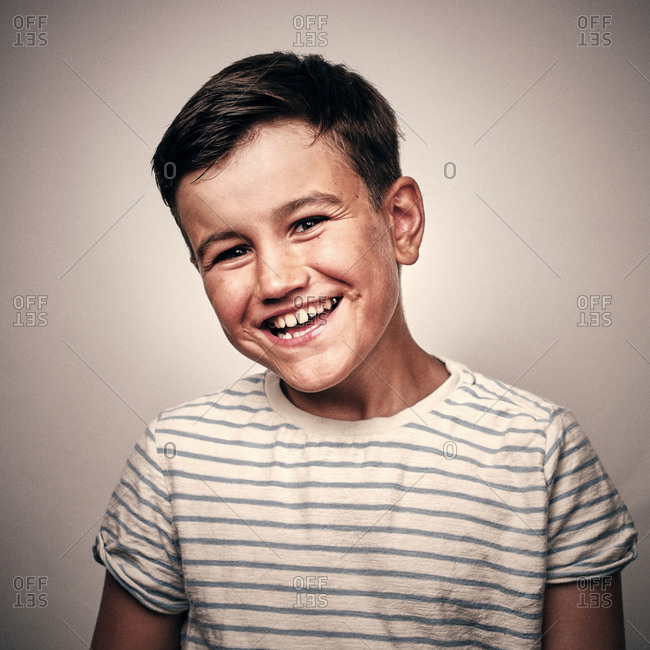 Portrait of a happy young boy smiling at the camera