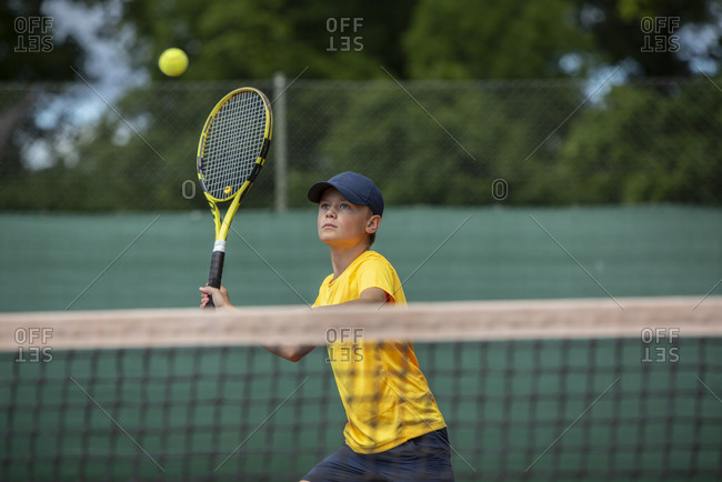 Boy playing tennis - Offset Collection