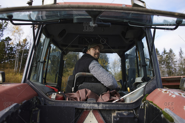 Farmer driving tractor - Offset Collection