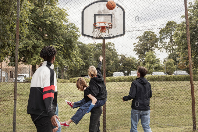Teenagers playing basketball - Offset Collection