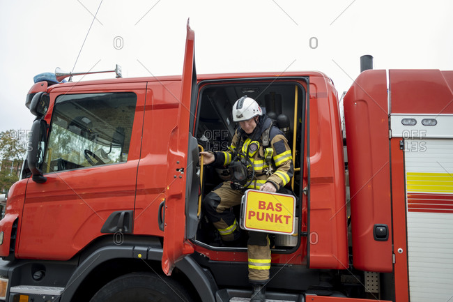 Firefighter leaving fire engine - Offset Collection