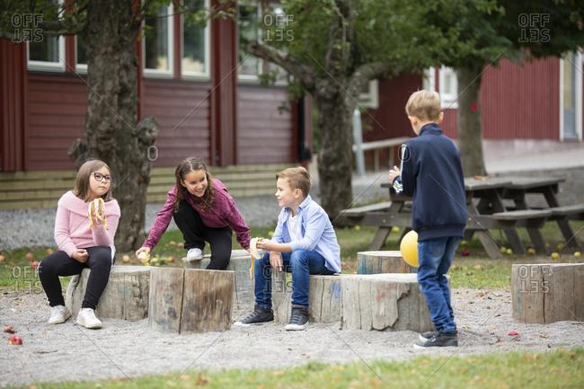 Children talking on playground - Offset Collection