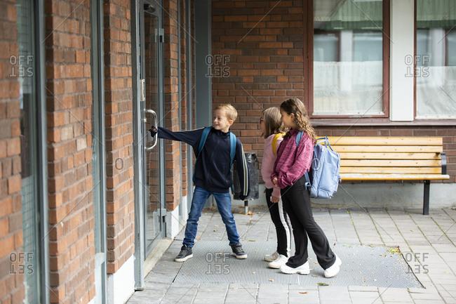 Children opening school door - Offset Collection