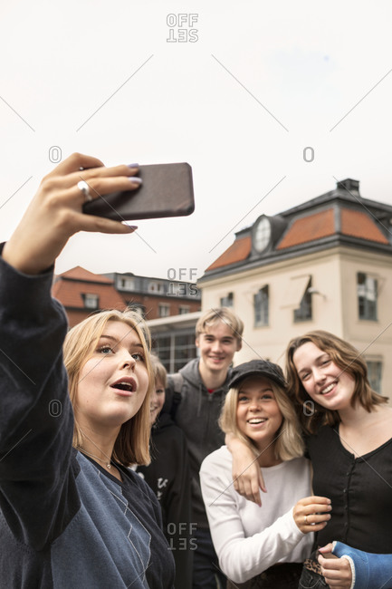 Smiling teenagers taking selfie - Offset Collection