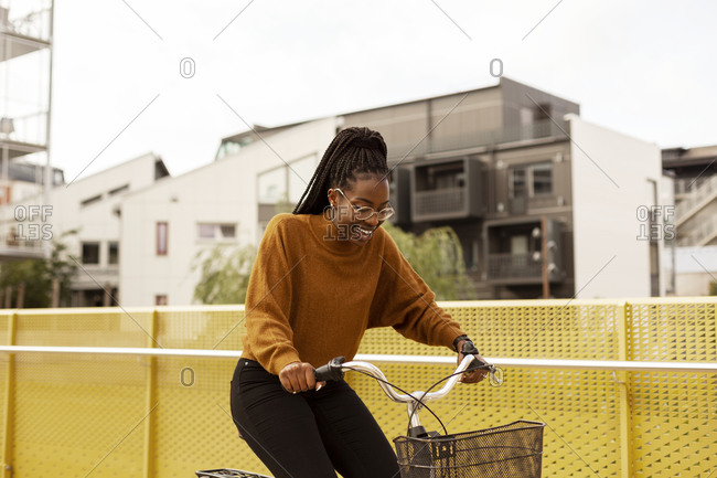 Smiling young woman cycling - Offset Collection