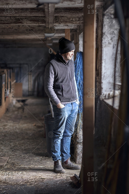 Man standing in stable - Offset Collection