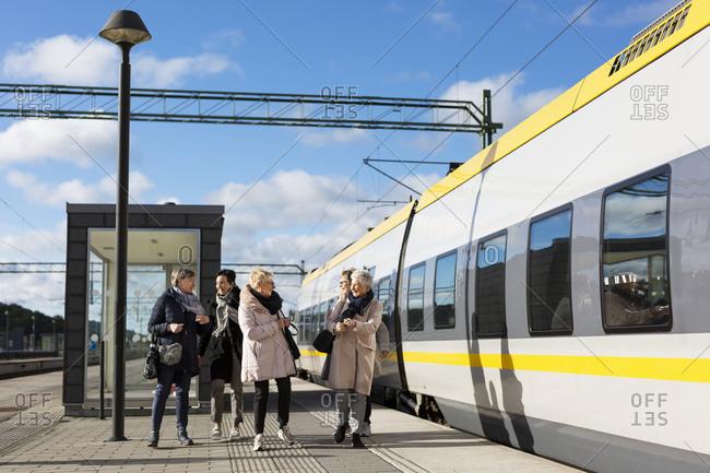 Passengers at train platform - Offset Collection