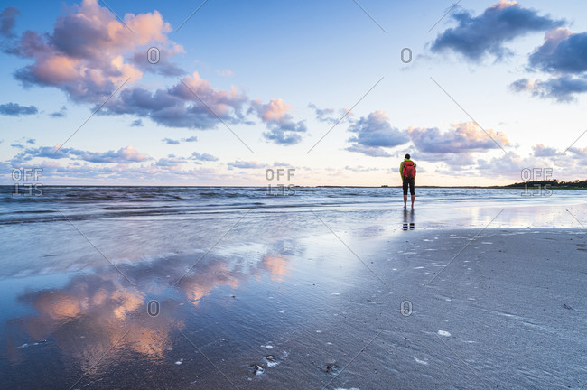 Hiker standing at sea - Offset Collection