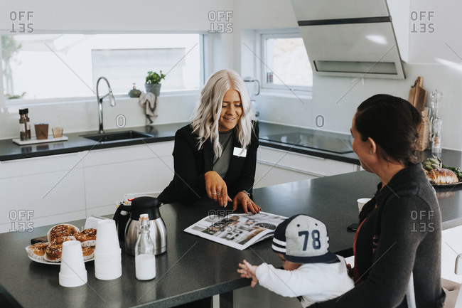 Estate agent showing woman house