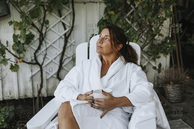 Woman relaxing with coffee mug